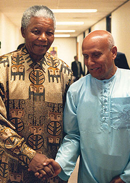 President Mandela with Sri-Chinmoy at the Presidential Mansion in Pretoria.jpg